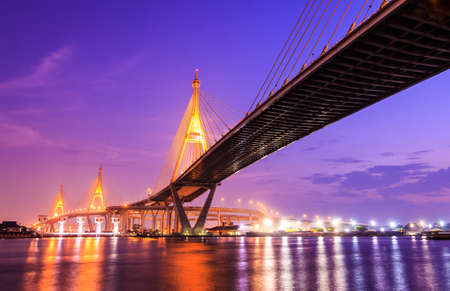 bhumibol: Bhumibol huge industrial bridge at dusk in Samut Prakarn Bangkok, Thailand Stock Photo