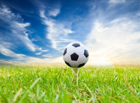 soccer ball on golf tee Stockfoto