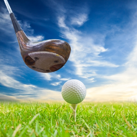 driver hit golf ball on tee photo