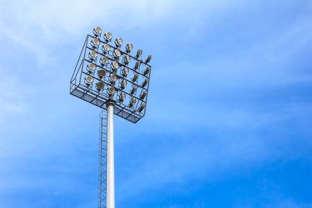 spot lit: big spotlight tower at sport arena stadium