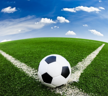 soccer ball on green grass field photo