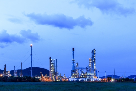 Oil refinery plant at dusk photo