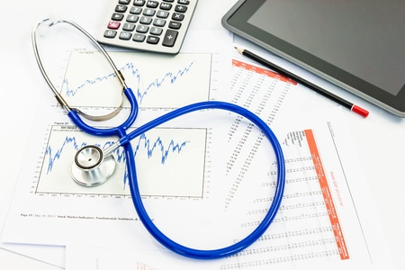 health check: stethoscope with financial graph