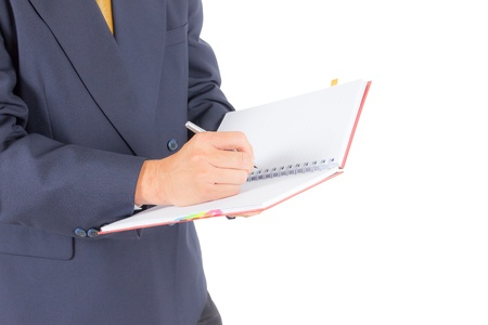 business man writing on notebook isolated with clipping path photo
