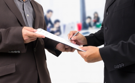 business man signing contract with business people background Stock Photo