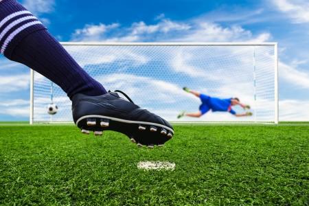 kick: foot shooting soccer ball to goal, penalty