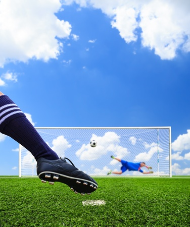foot shooting soccer ball to goal, penalty photo