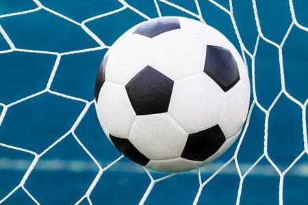 soccer ball in goal net photo