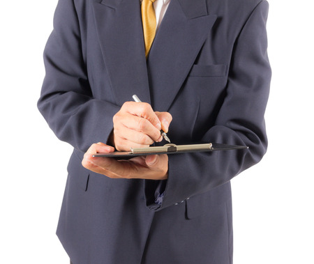 business man writing on notebook photo