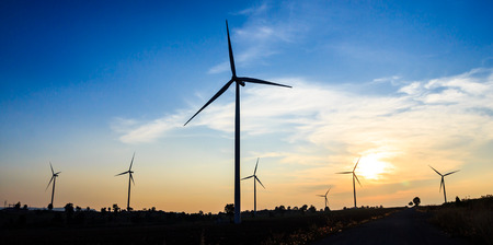 megawatt: silhouette wind turbine with dusk clean energy concept Stock Photo