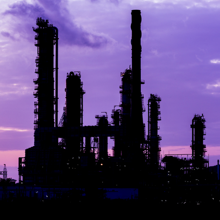 chemical engineering: silhouette of oil refinery plant at twilight morning