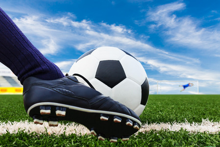soccer net: foot kicking soccer ball