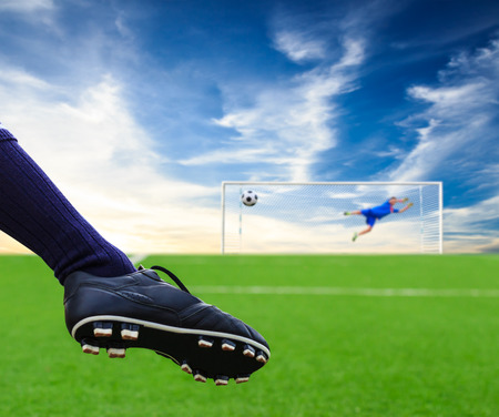 foot kicking soccer ball