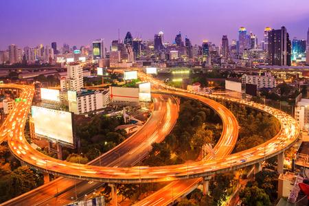 toll: bangkok expressway with cityscape at dusk