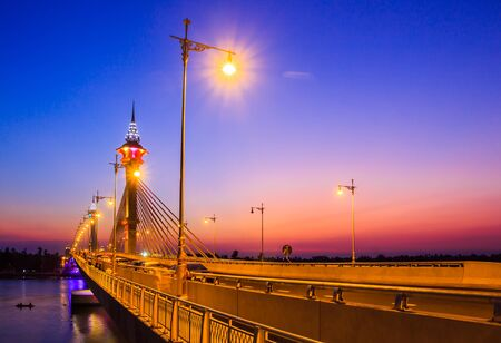 cable bridge: cable bridge and road street at dusk