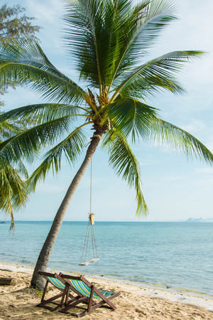 beach chair under coconut tree Stock Photo
