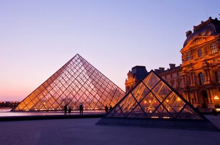 PARIS - APRIL 16 :Louvre at dusk on April 16, 2010 in Paris. Summer Exhibition at Louvre Museum