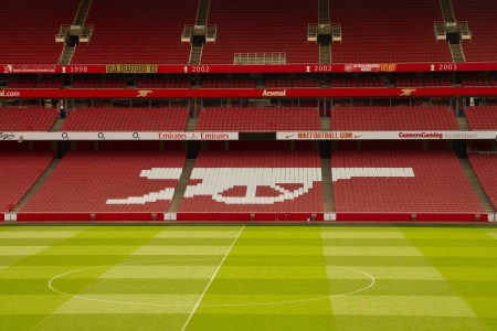 champions league: LONDON - APR 15. Emirate stadium tours in London, England. Emirate stadium is one of biggest stadium in UK, with 60,355 seats established on Ju 22, 2006 Editorial