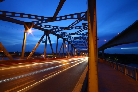 motorway: a long light tail on the main bridge Stock Photo