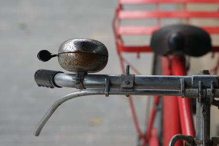 Old bell of red vintage bicycle.
