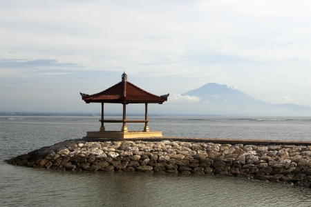 remoteness: Small pagoda and mountain in remoteness in Bali