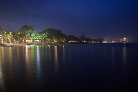 sanur: Sanur beach at night, blue sky and reflections on ocean