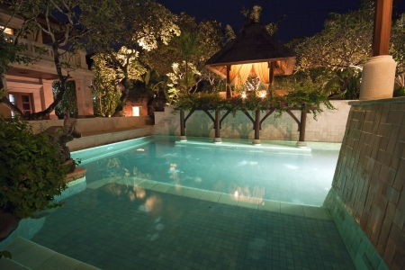 unoccupied: Unoccupied and lit swimming pool in Bali in dusk