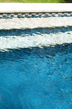 unoccupied: Steps to an unoccupied swimming pool