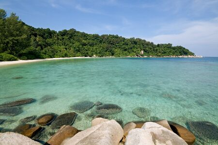 Beautiful and unoccupied beach and crystal clear waters in Malaysia photo