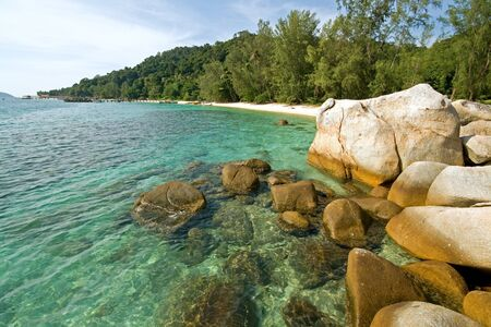 Rocks in shallow crystal clear waters in Malaysia photo