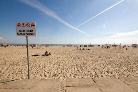 certain: Sign forbidding certain activities at a beach