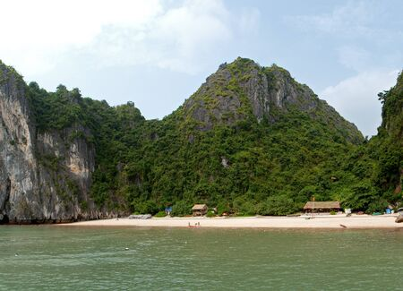 Beautiful and quiet beach with forest and limestone cliffs around photo