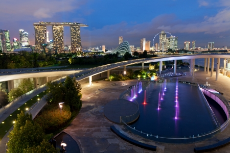 View of Marina Barrage and Singapore s city center at dusk photo