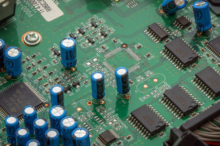 capacitors: Closeup of a microprocessors and capacitors on circuit board
