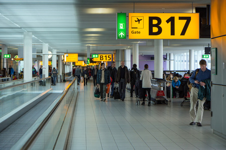 Passengers inside a terminal at the Amsterdam Airport Schiphol