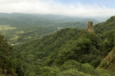 the crag: Landscape of lush hills, valley, crag and verdant forest in Pingxi, Taiwan Stock Photo