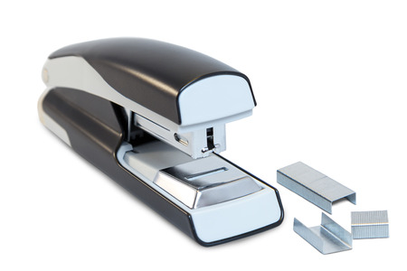 clerical: Closeup of a grey office stapler and staples, isolated on white background