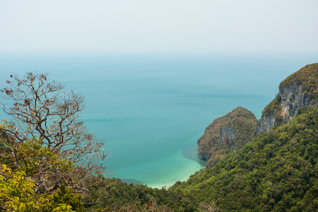 View of lush and hilly island, coastline and ocean from above at the Angthong (Ang Thong) National Marine Park in Thailand photo