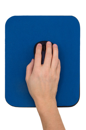 viewed: Hand on a black computer mouse on a blue mouse pad, viewed from above, isolated on white background