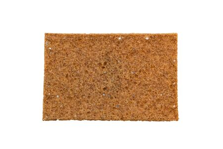 viewed: Closeup of a thin rye crispbread with sourdough rye, viewed from above, isolated on white background