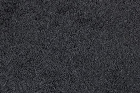 grey rug: Closeup of a dark grey carpet texture Stock Photo