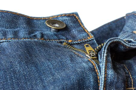 unbuttoned: Closeup of open unzipped and unbuttoned blue denim jeans isolated on white background