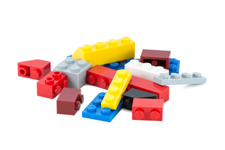 Close-up of pile of colorful Lego pieces isolated on white background
