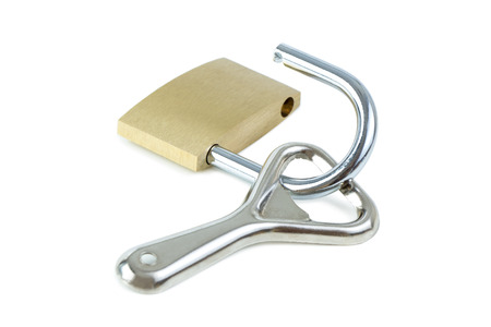 alcoholismo: Bottle opener and an unlocked padlock. Concept photo of drinking problem and alcoholism. Foto de archivo