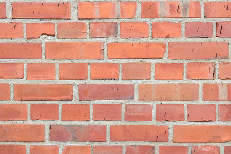 newer: Newer red brick wall texture background with black smudges
