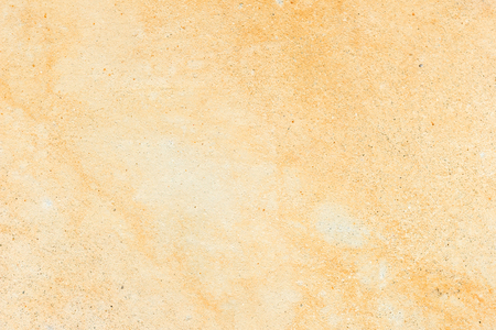 partly: Pale orange concrete wall texture background, paint partly faded Stock Photo