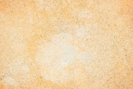 faded: Pale orange concrete wall texture background with a bit of vignetting, paint partly faded. Stock Photo