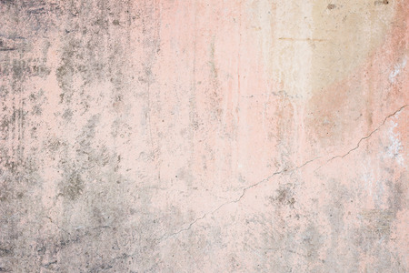 vignetting: Worn pale pink concrete wall texture background with a bit of vignetting, paint partly faded.
