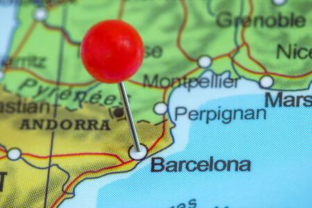 Close-up of a red pushpin on a map of Barcelona, Spain