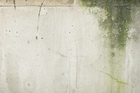 Weathered and moldy concrete wall with cracks texture